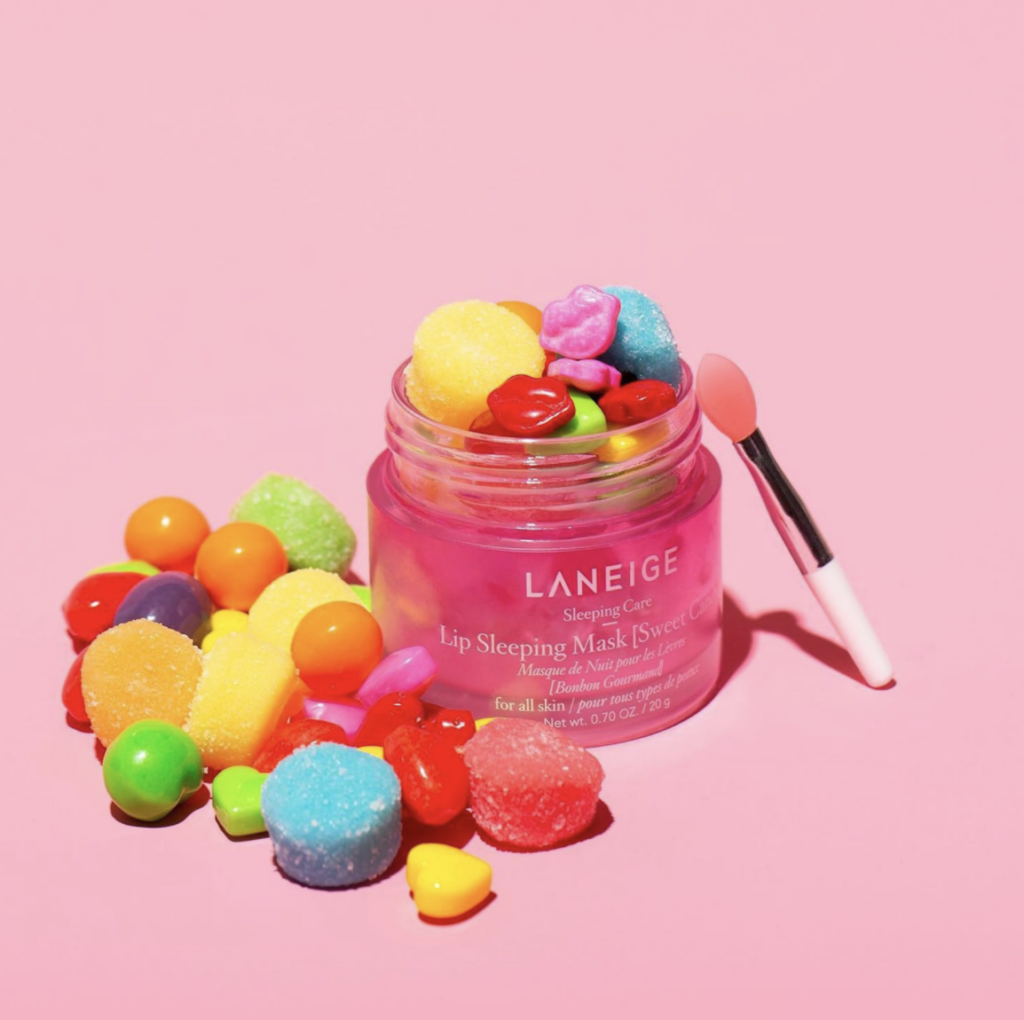 Langeige Lip Sleeping Mask with candy in and around it,  available at Sephora during Sephora Beauty Insider sale.